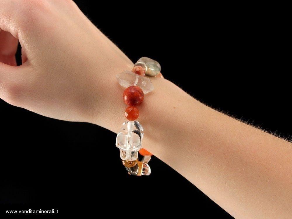Cristallo di rocca con corallo e corniola